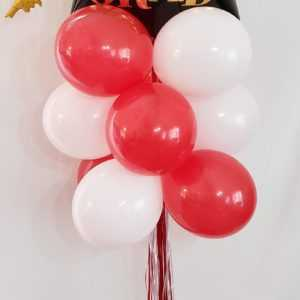 Do you need a special Grad theme balloon yard display? Let us make one of these for that graduate in your life using their school's colors.